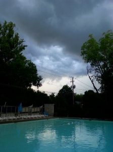 swimming pool and storm clouds